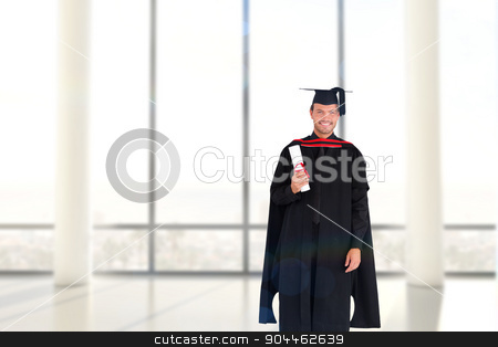 Composite image of charming graduate boy with his diploma  stock photo, Charming graduate boy with his diploma  against window overlooking city by Wavebreak Media