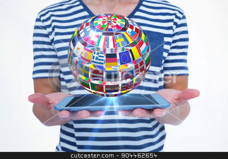 Composite image of close up of man holding tablet stock photo, Close up of man holding tablet against sphere made of flags by Wavebreak Media