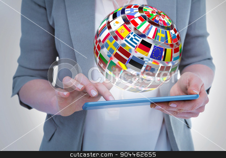 Composite image of close up of woman using tablet stock photo, Close up of woman using tablet against sphere made of flags by Wavebreak Media
