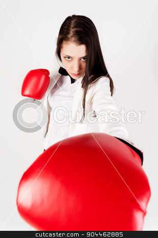 young businesswoman in boxing gloves stock photo, Serious business lady with red gloves fighting against white background by Aikon