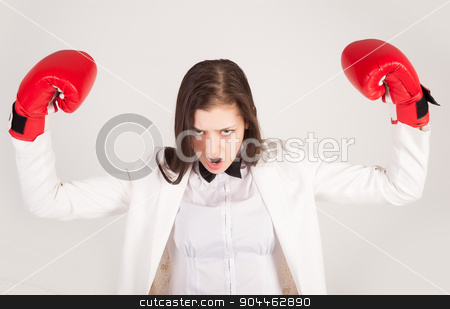 Angry businesswoman in boxing gloves stock photo, Angry business lady with red gloves fighting against white background by Aikon