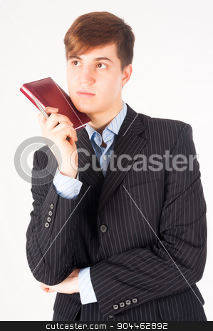 businessman holding diary log stock photo, Portrait of young businessman with organizer at white background by Aikon