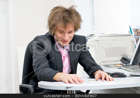 Businessman in office stock photo, Young businessman on office workplace with computer by Aikon