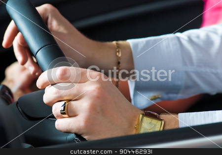 Driving man stock photo, Man hands of driver on steering wheel by Aikon