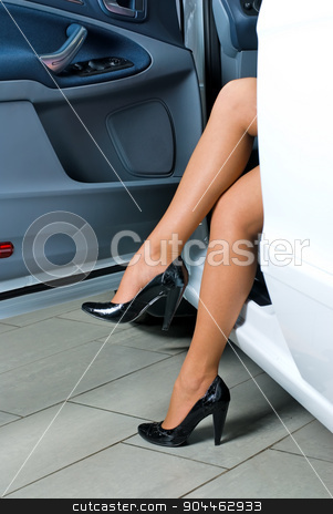 Pretty woman exiting from car stock photo, Young lady get out of the car by Aikon
