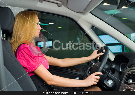 Pretty woman - driver stock photo, Woman Sitting In Car Getting Ready To Drive by Aikon