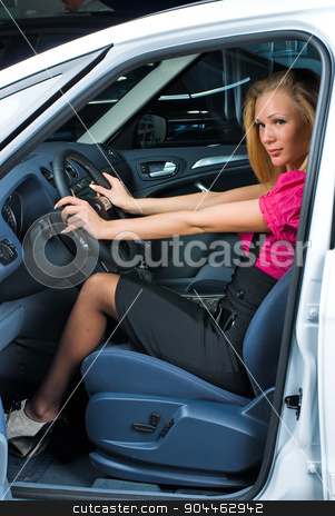 Pretty woman - driver stock photo, Young attractive woman sits in car and ready to drive by Aikon