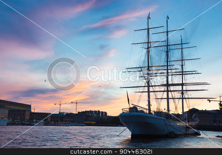Traditional seilboat in Gamla stan, Stockholm, Sweden, Europe. stock photo, Panoramic view of swedish capital Stockholm in sunset. Silhouette of large traditional wooden sailboat and old medieval downtown of Gamla stan in the background. Copy space. Horisontal composition. by kasto