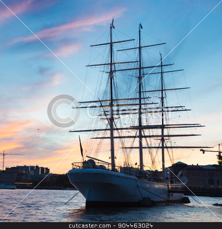 Traditional seilboat in Gamla stan, Stockholm, Sweden, Europe. stock photo, Panoramic view of swedish capital Stockholm in sunset. Silhouette of large traditional wooden sailboat and old medieval downtown of Gamla stan in the background. Copy space. Square composition. by kasto