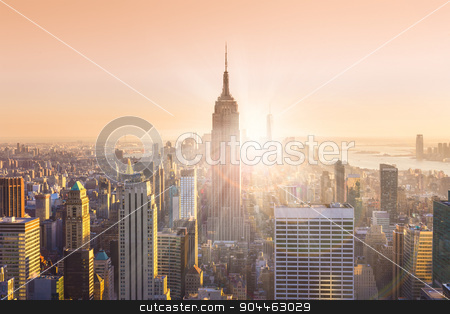 New York City Manhattan skyline in sunset. stock photo, New York City. Manhattan downtown skyline with illuminated Empire State Building and skyscrapers at sunset. Horizontal composition. Warm evening colors. Sunbeams and lens flare. by kasto