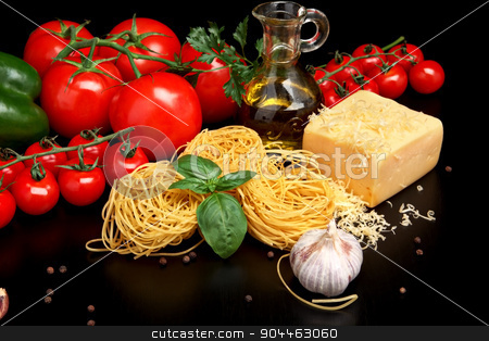 Round balls of pasta with cheese,tomatoes,basil,olive oil on black stock photo, Round balls of pasta with tomatoes,basil,olive oil on black background by Tadeusz Wejkszo