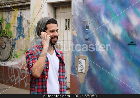 Young man talking on the phone. stock photo, Handsome young man talking on the phone. Trendy and urban scene. by nicolas menijes