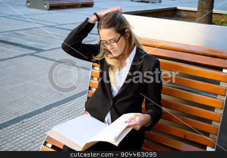 Beautiful business woman outside her office stock photo, Business woman working on a bench outside her office. Professional woman on her coffee break. by nicolas menijes