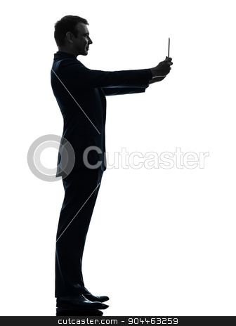 business man  photographing digital tablet  silhouette stock photo, one  business man holding photographing digital tablet in silhouette on white background by Ishadow