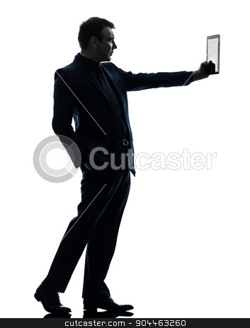business man  digital tablet  silhouette stock photo, one  business man holding digital tablet in silhouette on white background by Ishadow