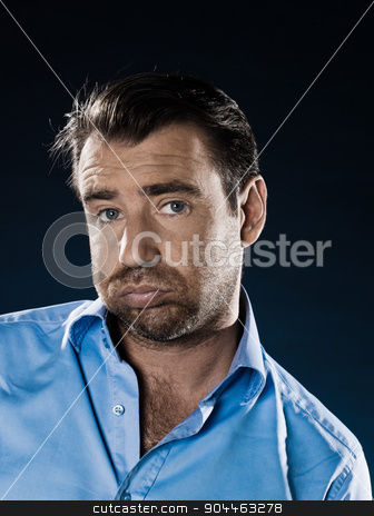 Man Portrait Despair Beg stock photo, man unshaved bored fed up portrait isolated studio on black background by Ishadow