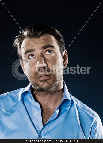 Man Portrait Despair Beg stock photo, man unshaven pensive looking up portrait isolated studio on black background by Ishadow