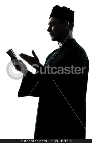 man priest silhouette reading bible stock photo, one  man priest reading bible silhouette in studio isolated on white background by Ishadow