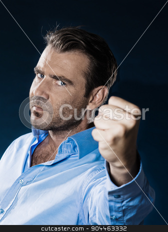 Man Portrait Angy Menacing stock photo, man unshaven angy menacing portrait isolated studio on black background by Ishadow