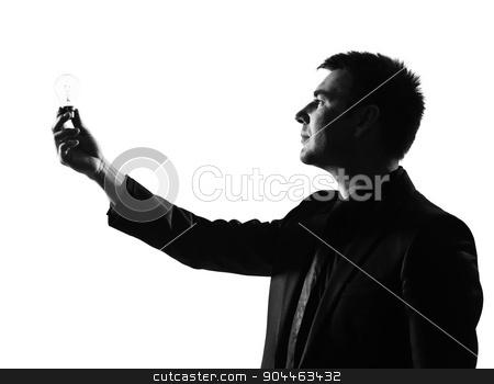 silhouette  man  holding light bulb stock photo, silhouette  business man holding light bulb expressing behavior full length on studio isolated white background by Ishadow