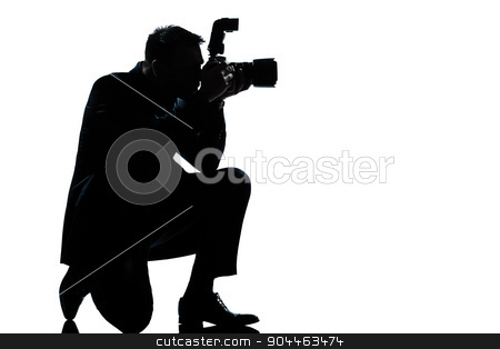 silhouette man kneeling photographer stock photo, one  man kneeling photographer full length silhouette in studio isolated on white background by Ishadow