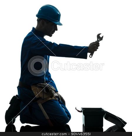 repair man worker despair praying silhouette stock photo, one  repairman worker despair praying silhouette in studio on white background by Ishadow