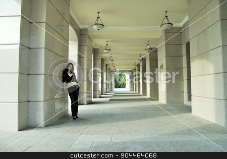 Attractive woman at city background stock photo, Young beautiful woman standing near city theater by Aikon