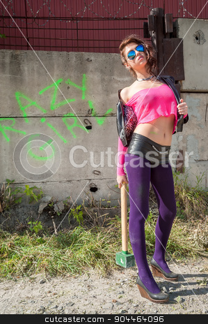 Pretty girl in pink net blouse with sledge hammer stock photo, Young beautiful woman in pink net blouse and leather jacket with sunglasses holding sledge hammer by Aikon