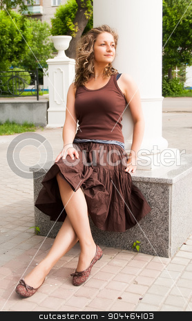portrait of young beautiful woman stock photo, Portrait of beautiful young brunette woman wearing brown dress at summer green park. by Aikon
