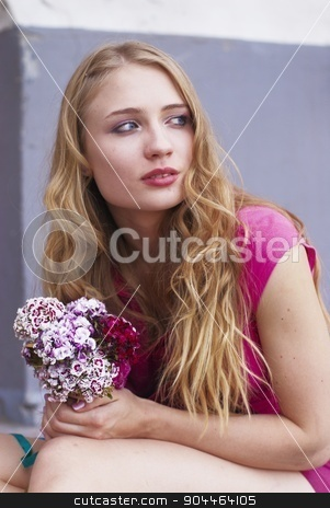 Waiting pretty  girl with bouquet stock photo, Young attractive woman sitting near entrance of house by Aikon