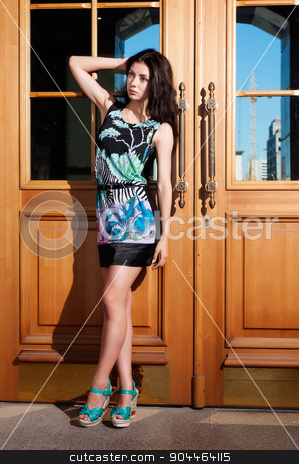 beautiful young girl in dress stock photo, Fashion style photo of a young woman at urban background by Aikon