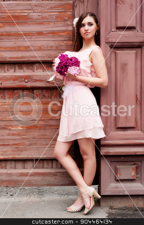 beautiful woman with flower stock photo, Portrait of a beautiful blonde woman with peony flowers at old wooden house background by Aikon
