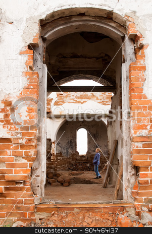Woman in ruin church stock photo, Pretty woman walking in old ruin church. Romanovo. Tyumen region. Russia by Aikon