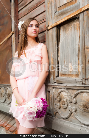 beautiful woman with flower... stock photo, Portrait of a beautiful blonde woman with peony flowers at old wooden house by Aikon
