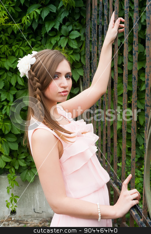 Attractive woman with flower hairstyle stock photo, Portrait of a beautiful brunette woman with peony flower hairstyle. Fashion photo by Aikon