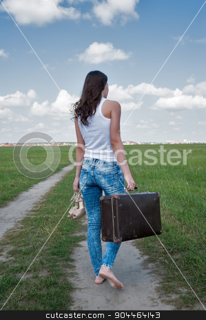 Attractive woman with old suitcase goes afar stock photo, Beautiful woman with old suitcase goes afar on unpaved road by Aikon