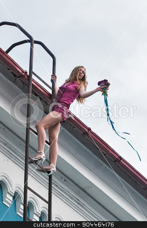 Pretty girl with bouquet on stairs stock photo, Young beautiful blond woman standing on fire staircase by Aikon