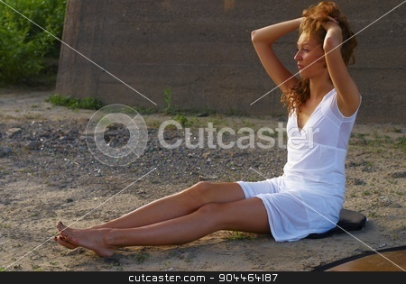 Attractive woman on beach stock photo, Young beautiful woman sitting on sand of beach by Aikon