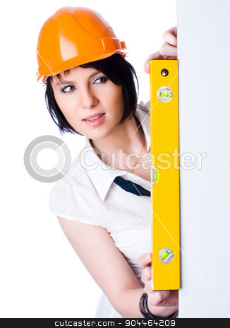 Pretty girl in helmet with level stock photo, Young attractive worker with protection helmet and level at isolated background by Aikon