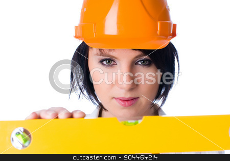 Attractive woman with measuring level stock photo, Young pretty worker with protection helmet and level at isolated background by Aikon