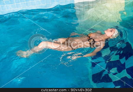Pretty girl in swimming pool stock photo, Young beautiful sexy woman relaxing in swimming pool by Aikon