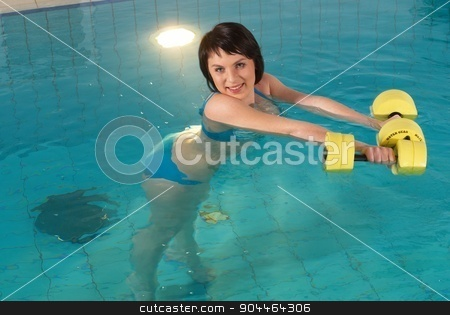 Aquaaerobic girl stock photo, Young woman making aquaaerobic training in fitness center pool by Aikon