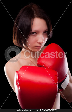 beautiful nude girl with boxing gloves stock photo, Half body portrait of sexy young brunette woman with red boxing gloves covering breasts, Isolated over black by Aikon