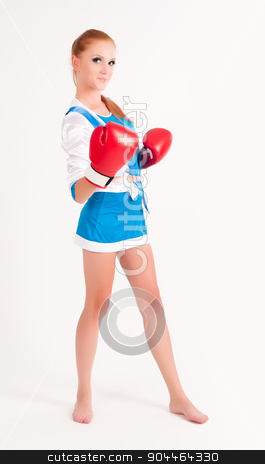 woman with boxing gloves stock photo, Young beautiful woman during fitness and boxing by Aikon