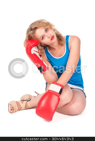 Pretty sad girl with boxing gloves stock photo, Young blonde woman with boxing gloves sitting on floor by Aikon