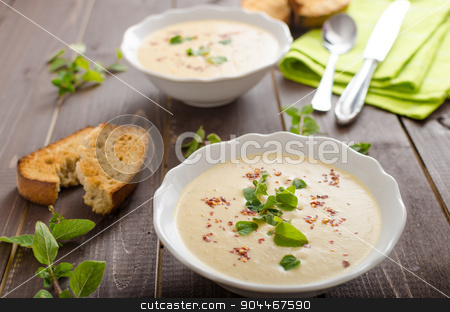 Creamy zucchini soup with chilli and oregano stock photo, Creamy zucchini soup with chilli and oregano, crispy bread with garlic by Peteer