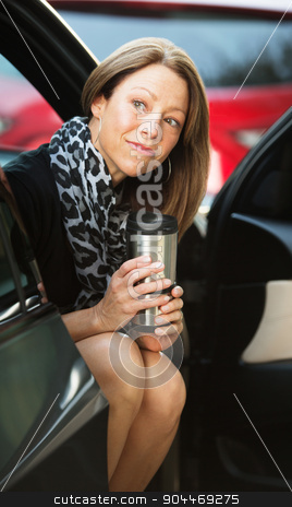 Cute Worker with Coffee in Car stock photo, Cute executive sitting in car with open door by Scott Griessel
