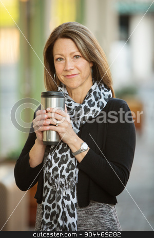 Cute Woman with Metal Flask stock photo, Cute businesswoman with aluminum coffee flask outdoors by Scott Griessel