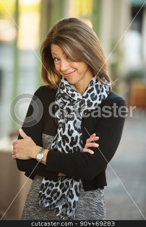 Grinning Business Woman Outdoors stock photo, Grinning middle aged woman with folded arms outdoors by Scott Griessel