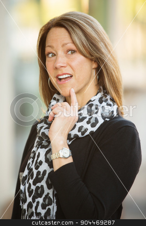 Beautiful Curious Woman stock photo, Cute woman with a thinking expression outdoors by Scott Griessel